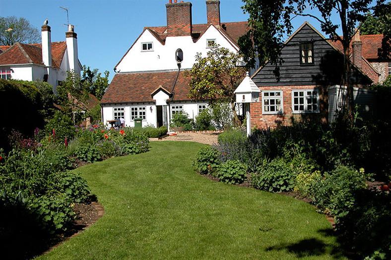 village-garden-lawn-and-house